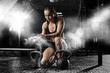 Woman Workout With Kettlebells...