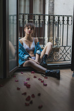 Woman In Lingerie And Boots In Doorway
