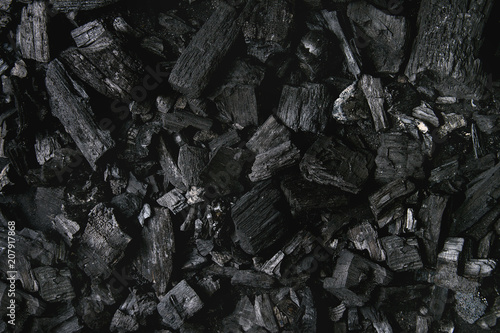 Black charcoal texture abstract surface background. Top view Wallpaper Mural