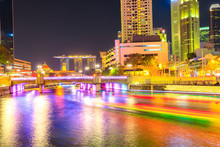 Clarke Quay Bridge And Riverside Area At Night In Singapore, Southeast Asia. Waterfront Skyline Reflected On Singapore River. Popular Attraction For Nightlife. Scenic Cityscape Mirroring In The Water.