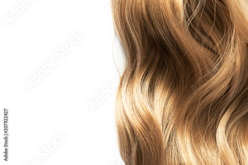 Fotografía  long blond wavy hair isolated on white background