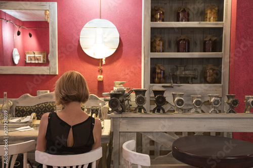 A girl is sitting in an authentic cafe