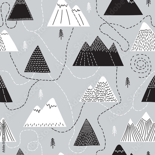 Photo  Cute hand drawn seamless pattern with trees and mountains