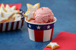 canvas print picture - Homemade Star Shaped Sugar Cookies and Homemade Strawberry Ice Cream Served in Red, White, and Blue Paper Products against a Blue Background