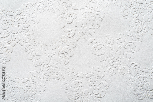 Valokuva  White acrylic texture, painted surface with embossing, grunge pattern