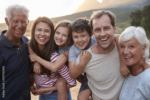Fotografie, Obraz  Portrait Of Multi Generation Family On Countryside Walk By Lake