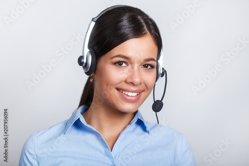 Fotografía  customer support phone operator in headset, with blank copyspace area for slogan or text message, over grey background