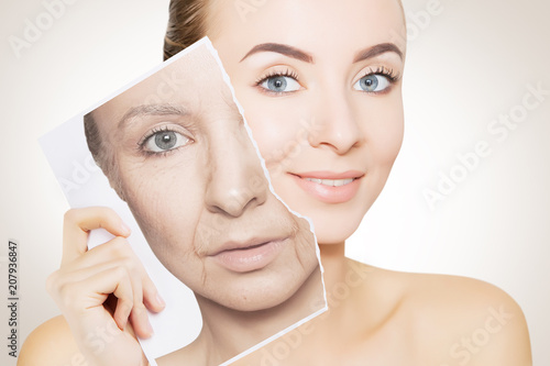 Photo portrait of young woman face holding portrait with old wrinkled face