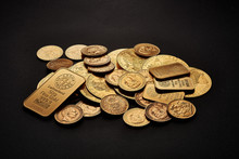 Yellow Gold Bars And Coins Isolated On Black Background
