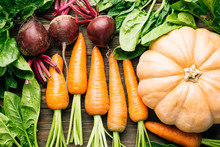 Carrots, Beets, Spinach, Pumpkin On A Wooden Background, Fresh Vegetables