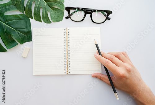 Fotografie, Obraz  close up man hand using black pencil and prepared to writing on mock up notebook