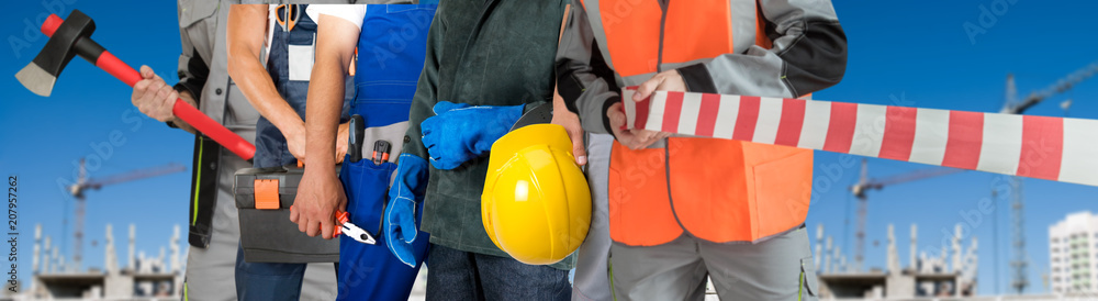 Fototapety, obrazy: Many workers closeup with equipment on building background
