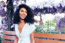 Happy Young Black Woman Sittin...