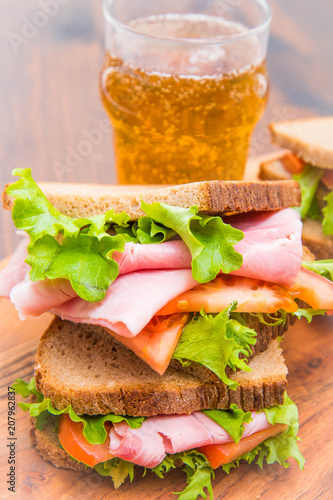 Foto op Plexiglas Buffet, Bar sandwiches with ham, saladf and tomatoes