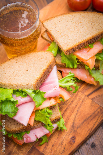 Foto op Plexiglas Buffet, Bar sandwiches with ham and smoked salmon with beer glasses