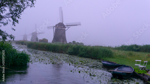 Slika na platnu Dutch Windmill in dawn at the polder