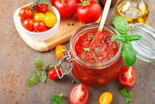 Tomato Sauce In A Glass Jar An...