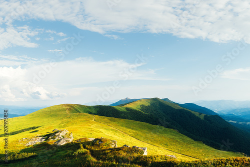 Foto op Plexiglas Pool View of the stony hills glowing by evening sunlight. Dramatic spring scene. Chornohora ridge, Carpathians, Ukraine, Europe.