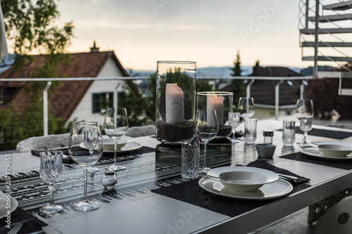 Table setting for romantic dinner on the terrace of luxurious house