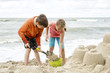 Children making castle with sand