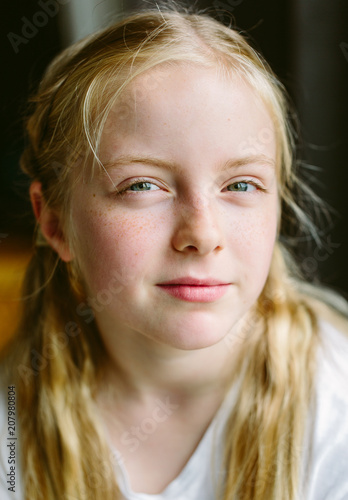 Portrait of a preteen girl with a look of defiance on her face.