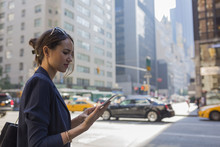 Young Businesswoman Working With A Digital Tablet In Manhattan ,