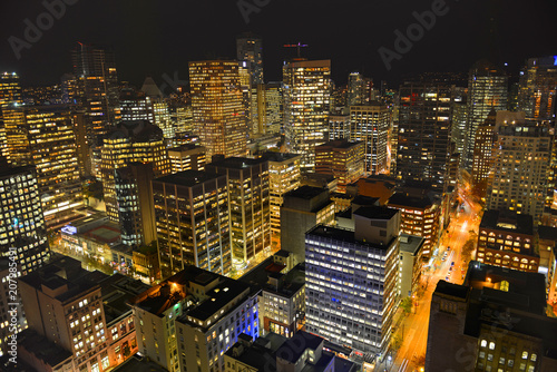 Fotobehang Stad gebouw Vancouver city financial district at night, photo taken from the Harbour Centre tower, Vancouver, British Columbia, Canada.