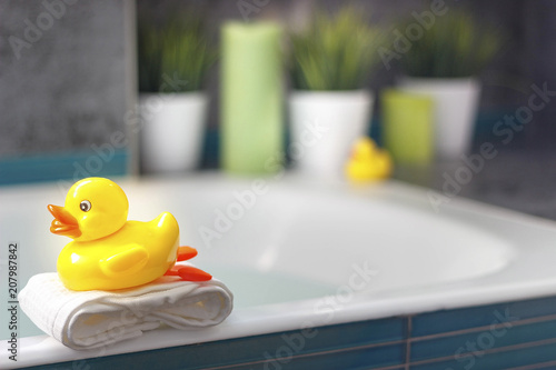Fototapeta yellow duck in the bathroom, interior details on the bathtub