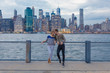 Young Couple in Front Of Manhattan Skyline . New York City US