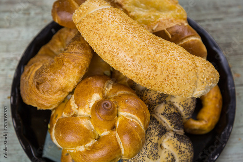 Poster  Gourmet selection of fresh bread rolls and a pretzel with seeded buns, croissant