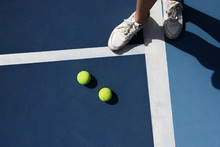 Tennis Player Standing At Balls
