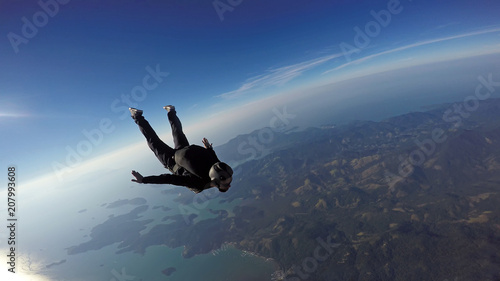 Fotografie, Obraz  Skydiver jump over the sea and mountains