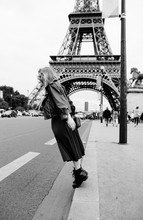 Stylish Woman Having Fun In Front Of The Eiffel Tower In Black And White