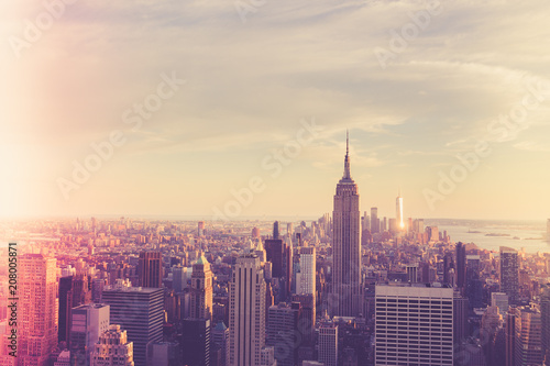 Fotobehang New York City Vintage style image of buildings across New York City at sunset with retro filter