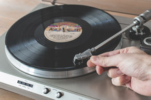 Hand Placing Needle Of Record Player To A Spinning Vinyl