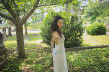"""""""Walking With A Ghost"""" Brunette Young Adult Woman In A White Slip Dress Dancing Around In A Graveyard Cemetery"""