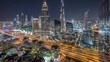 Dubai downtown skyline night timelapse with tallest building and road traffic, UAE