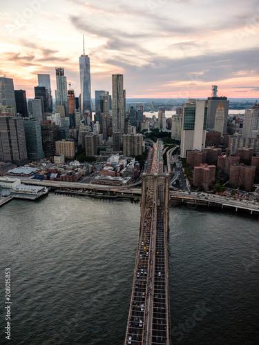 Above the Brooklyn Bridge leading into the borough of Manhattan.