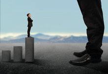 Business Concept.Tiny Businessman Looking Up On Giant Legs Of Another Businessman.Career Growth And Opportunities.a Small Business Looking Up A Big Business