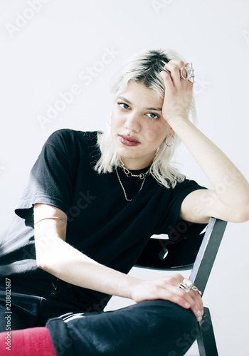 Keuken foto achterwand Centraal Europa Portrait of modern young woman sitting on a chair.