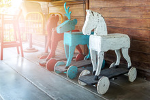 Vintage Rocking Animal In Old House. Old Rustic Toy In Wooden House