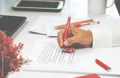 Obraz na plátně  proofreading paper on table
