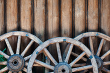 Three Old Wooden Wheels From C...