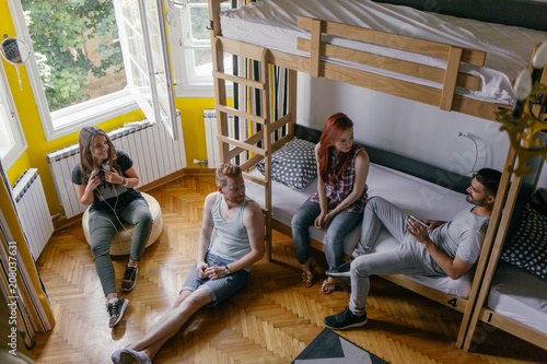 Young People Talking in a Hostel Room