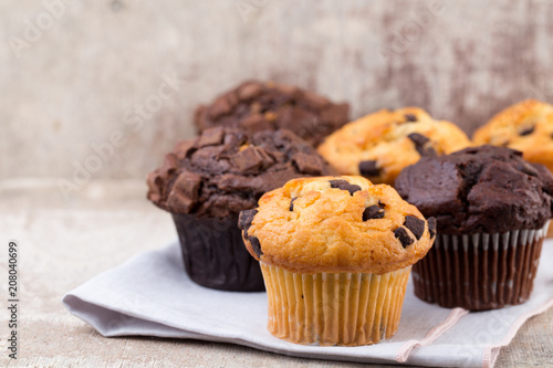 Homemade muffins with chocolate, vintage background. Wallpaper Mural