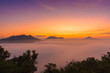 mountains under mist in the morning with sunrise at Phutoke Loei Thailand