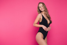 Enjoy Yourself! Close Up Photo Of The Cheerful Attractive Young Woman Wearing Black Sexual Lingerie Posing At The Camera.