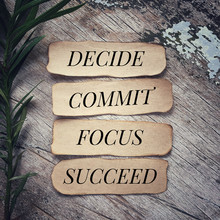Motivational And Inspirational Quote - 'Decide, Commit, Focus, Succeed' Written On Pieces Of Papers. With Vintage Styled Background.