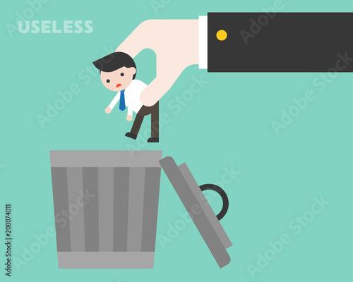 Fotografía Big business hand throwing small businessman to trash bin, useless person concep