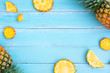 canvas print picture - Tropical pineapple on wood plank blue color. frame layout summer vacation background concept..